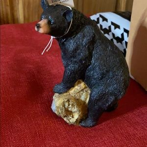 Bear on logs and rocks